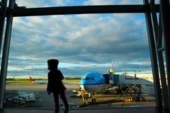 Kid near airport window Royalty Free Stock Photography