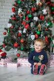 Kid near new-year tree Stock Photo
