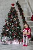 Kid near new-year tree Stock Photography