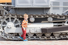 Kid near the tractor tracks Royalty Free Stock Photo