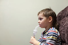 Kid with nebulizer Royalty Free Stock Image