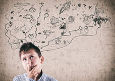 Kid next to a painted wall. Suggesting imagination, chaotic and creative world Stock Photos