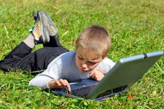 Kid with notebook Royalty Free Stock Photos