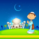 Kid offering namaaz for Eid celebration Stock Photography