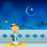 Kid offering namaaz for Eid celebration Royalty Free Stock Image