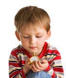 Kid with old clock Stock Photo