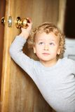 Kid opened a door. Royalty Free Stock Photography