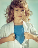 Kid opening his shirt like a superhero Royalty Free Stock Photos