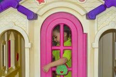 Kid opening playhouse door Royalty Free Stock Images