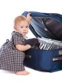 Kid opening a suitcase royalty free stock photo