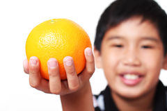 Kid with orange fruit Royalty Free Stock Images