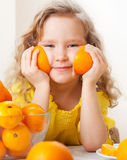 Kid with oranges Royalty Free Stock Photo