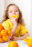 Kid with oranges Royalty Free Stock Images