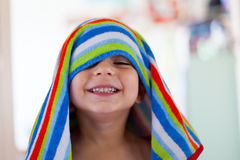 Kid out of the bath with wet hair and towel Royalty Free Stock Images