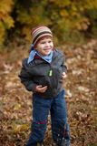 Kid outdoor in autumn Stock Images