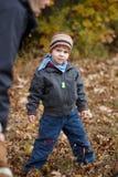 Kid outdoor in autumn Stock Image