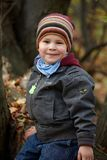 Kid outdoor in autumn Stock Images