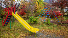 Kid outdoor playground with autumn color royalty free stock photography