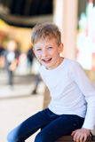 Kid at outdoor shopping mall Stock Images