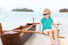 Kid at outrigger canoe Stock Photo