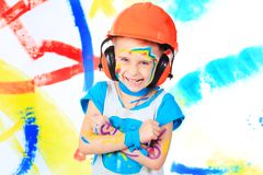 Kid with paint Stock Images