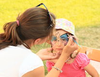 Kid painted on face. Kid - little girl painted on face at Conquest of water castle Svihov (Czech Republic, the 5th of Jule 2015 stock image