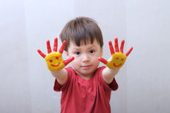 Kid with painted hands Stock Photography