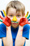 Kid with painted hands. Portrait of a cute boy with painted hands royalty free stock photos