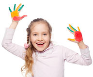 Kid with painted palms Royalty Free Stock Image