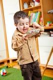 Kid painting. Preschool boy painting in his room Royalty Free Stock Image