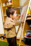 Kid painting Stock Photography
