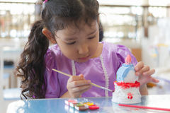 Free Kid Painting Color On The Plaster Statue Stock Photo - 65803270