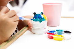 The kid painting color. On the plaster statue Royalty Free Stock Images