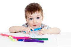Kid painting by colorful felt-tip pens Stock Photography