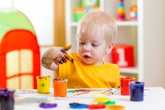 Kid painting at home Stock Photos