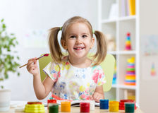 Kid painting at home or day care center Stock Photography