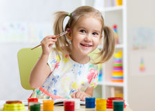 Kid painting at home Stock Photography