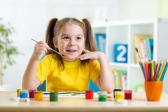 Kid painting at home Royalty Free Stock Photography