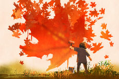 Kid painting maple leaves shape on the wall Royalty Free Stock Photos