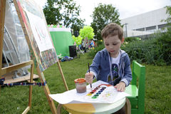 Kid painting paints Royalty Free Stock Image
