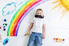 Kid painting rainbow Royalty Free Stock Photo