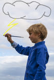 Kid painting in the sky stock photos