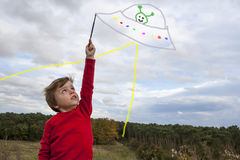 Kid painting in the sky royalty free stock photos