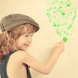 Kid painting wall Royalty Free Stock Images