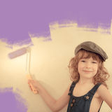 Kid painting wall Royalty Free Stock Photography