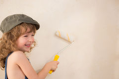 Kid painting wall Stock Photography