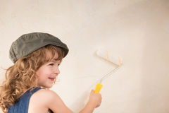 Kid painting wall Stock Images