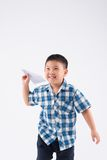 Kid with paper plane Royalty Free Stock Photos
