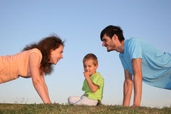 Kid and parents Royalty Free Stock Photo