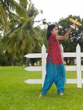 Kid in the park with her toy aeroplane. Asian kid in the park with her toy aeroplane Royalty Free Stock Photo